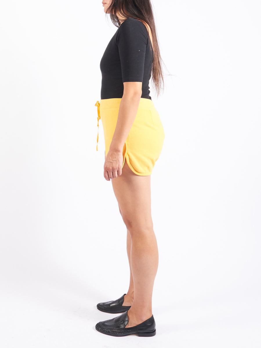 raquel-allegra-golden-yellow-running-shorts-on-body