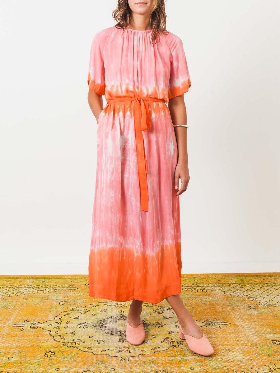 raquel-allegra-grapefruit-reversible-flutter-dress-on-body