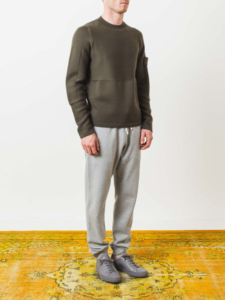 stone-island-olive-knit-sweater-on-body