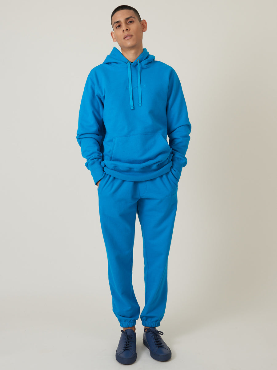 aimé-leon-dore-Navigate-Blue-Logo-Hoodie-on-body