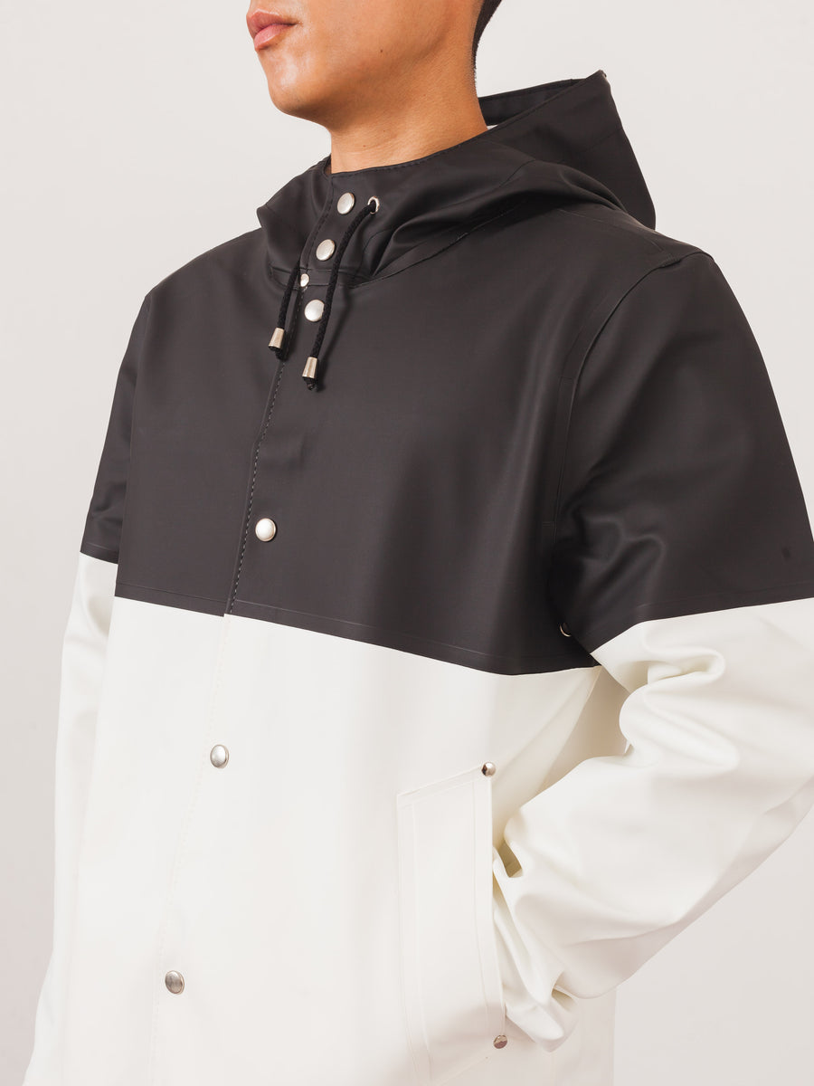 stutterheim-Stockholm-Black/White-Colorblock-Raincoat-on-body