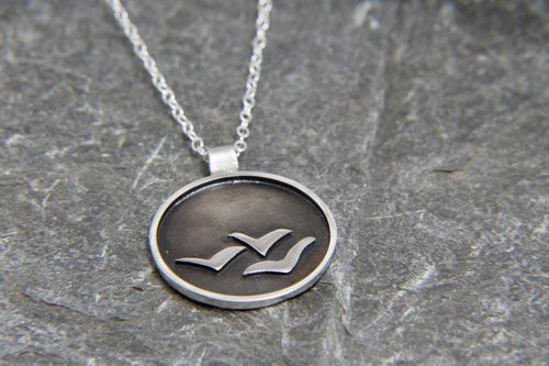 Soaring High Against Dark Clouds Necklace
