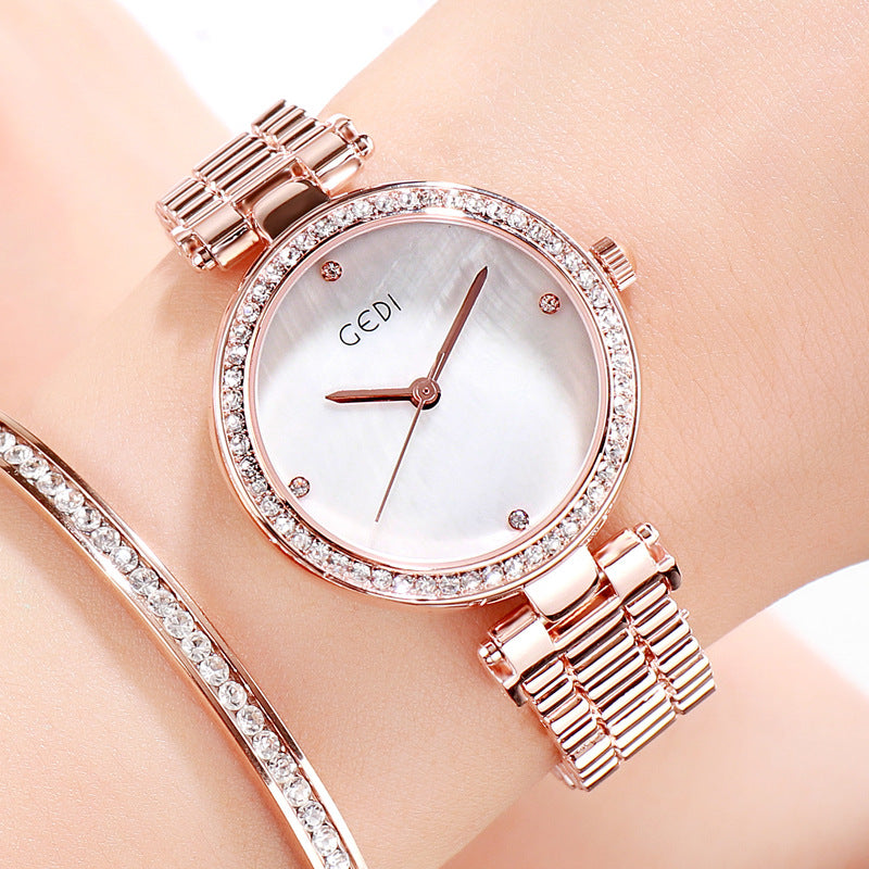 Delicate diamond-encrusted steel with quartz watch
