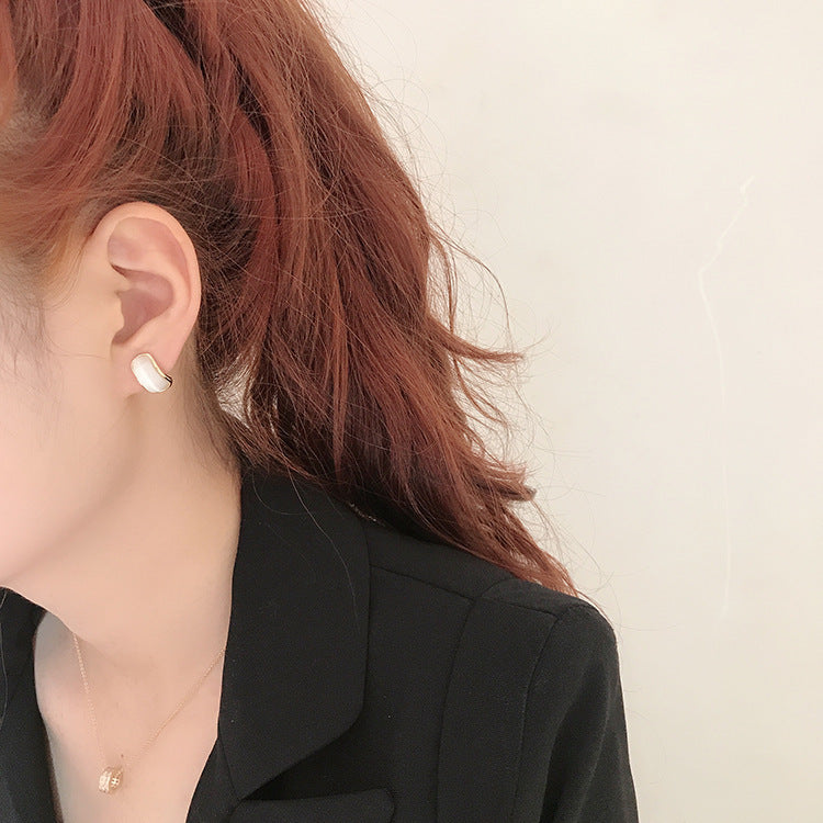 Simple hundred-touch cat-eye stone arc 925 ear pin