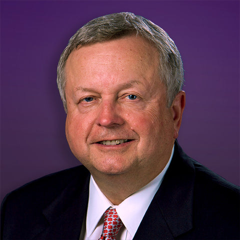 Man poses against purple background