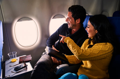 man on woman on a plane