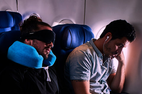 man sleeping on plane with mask