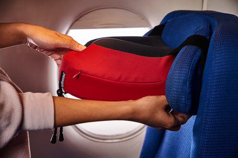cabeau pillow attached to plane seat