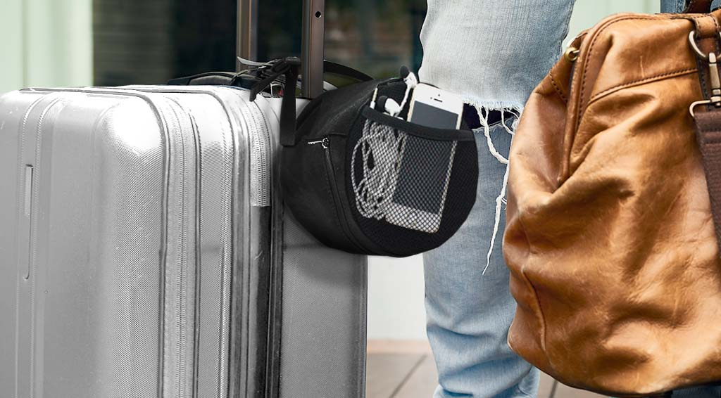Travel pouch attached to luggage