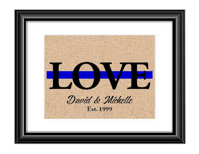 Showcase your love with this Personalized Police Thin Blue Line Love Print. This particular print has the word LOVE in large capital letters with a green line through the middle and underneath it is personalized with the couples first names and established date.  Police Love Thin Blue Line Personalized Burlap or Cotton Print