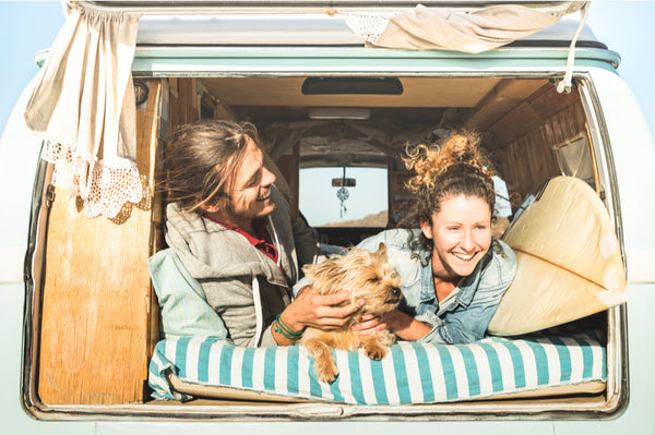 Couple in Camper Van with Dog