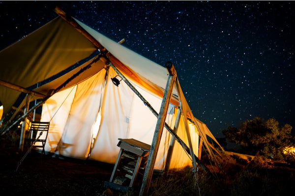 glamping tent underneath night sky stars