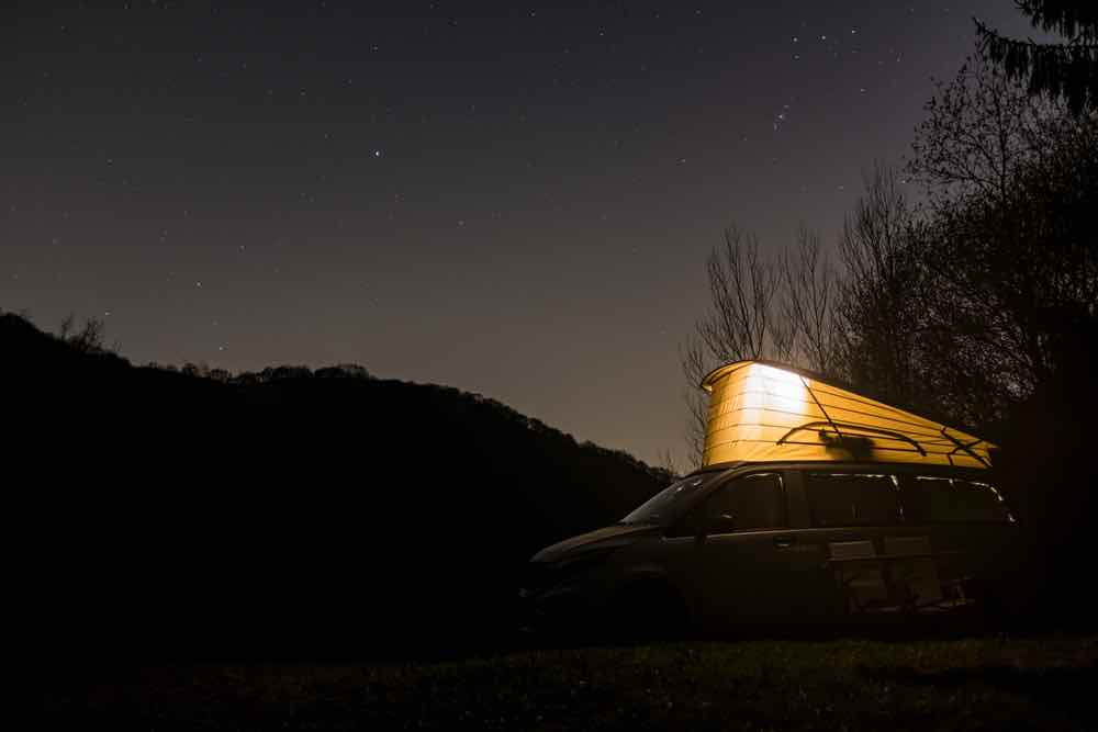Van camping under the stars