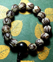 Wrist mala in carved Lotus style seeds - Vegetable ivory.