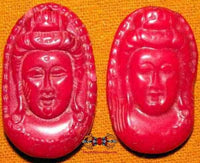 Guan Yin face - red coral (tinted)