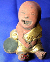 Small statue of the laughing Buddha - Master Chang-Ee