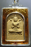 Buddha amulet with two lotuses.