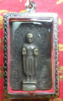 Large amulet of the standing Buddha.