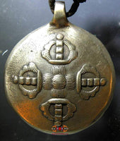 Tokchag Tibetan amulet shaped as a Melong Meditation Mirror.