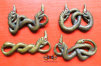 Large Nâgas talismans and intertwined snakes from Cambodia.