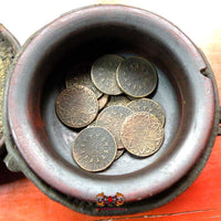 Fortune coins from ancient Thai temple.