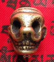 Tibetan Mala bead in bronze in the shape of human skull smiling Citipati.