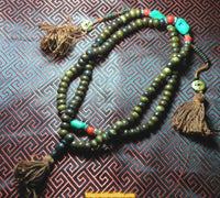Mala in yak bone (with counters) - dark color with turquoise and coral beads
