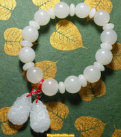Guan Yin wrist mala in white glass.