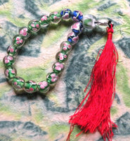Buddhist glass wrist rosary with floral decoration.