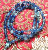 Large Buddhist rosary in blue marbled glass.