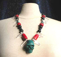 Tibetan style necklace with a large turquoise skull.
