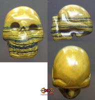 Human skull carved from iron eye (tiger eye + hematite).