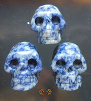 Human skull carved from blue stone (sodalith).