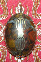 Sacred stone pendant from Mount Kailash.