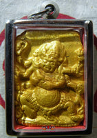Gold color Tsa Tsa Tibetan amulet  of white Mahakala.