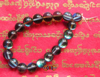 Buddhist wrist rosary in opal blue glass.
