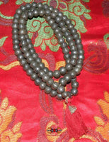 Tibetan mala in iron beads adorned with mantra.