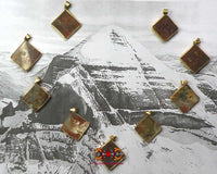 Small sacred stone pendants from Mount Kailash.