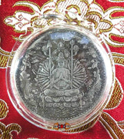 Chinese temple coin - Avalokiteshvara with thousand arms.