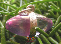 Lingam crystal pendant from Nâgas in lilac color.