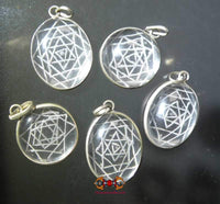 Shri Yantra pendant in rock crystal (quartz).
