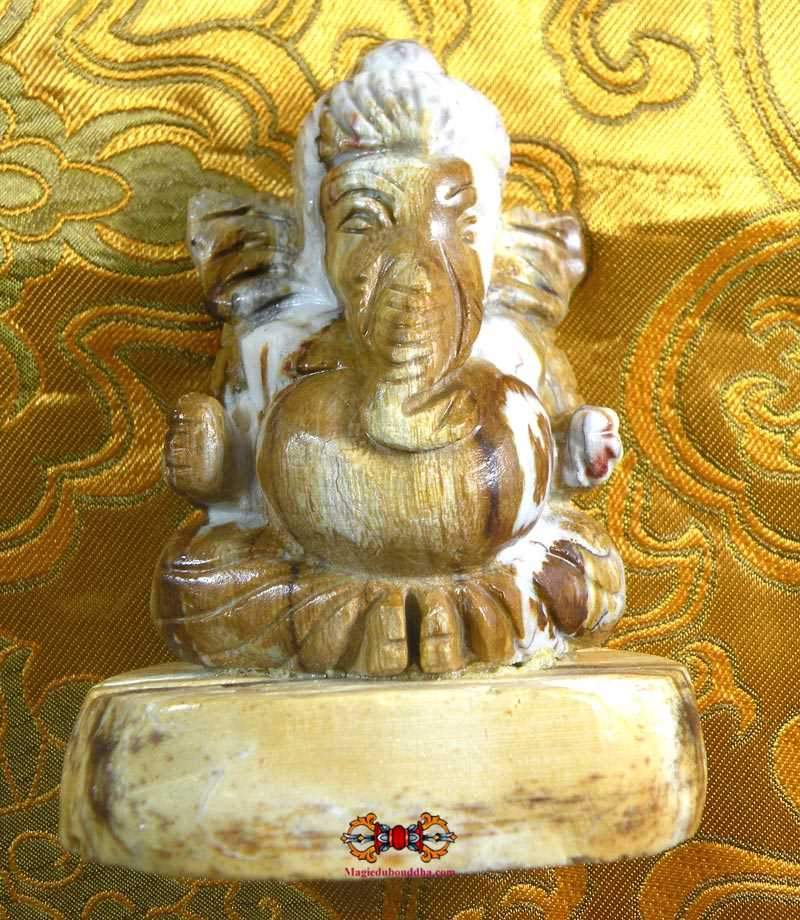 Statuette of Ganesh in fossil wood