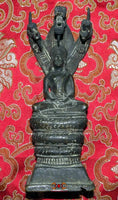 Beautiful old statue of the Buddha under the King of the Nagas.
