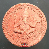 Large red amulet of Ganesh and Brahma.