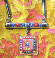 Tibetan Yantra amulet and sacred pills Rilbu from Simhamukha - Dakini with the face of a lion.