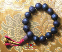 Wrist mala in authentic Bodhi seeds.