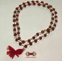 Mala in small sacred seeds Rudraksha and crystal.