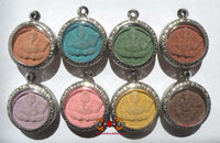 Collection of eight Ganesh amulets in the colors of the days of the week - Wat Kaek.