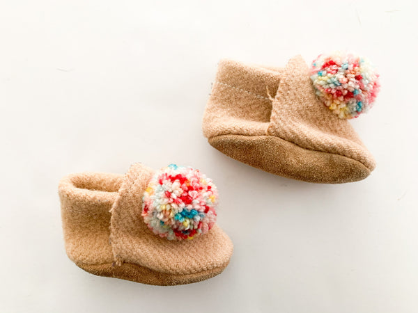 Tan knit mocs with poms size 4 inches