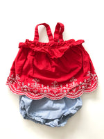 Red top with white flowers and blue bloomers